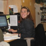 Kate at her desk before the twins were born